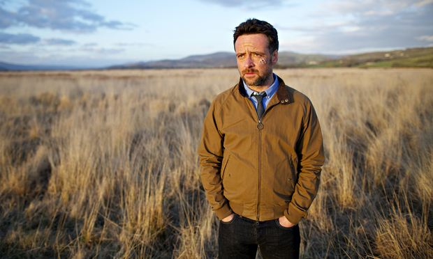 Richard Harrington as DCI Matthias in Hinterland, standing in a field, looking a bit sad.