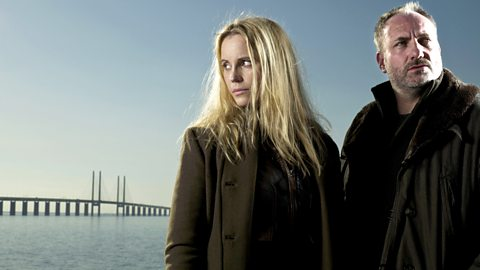 Saga and Martin stand in front of the Oresund Bridge