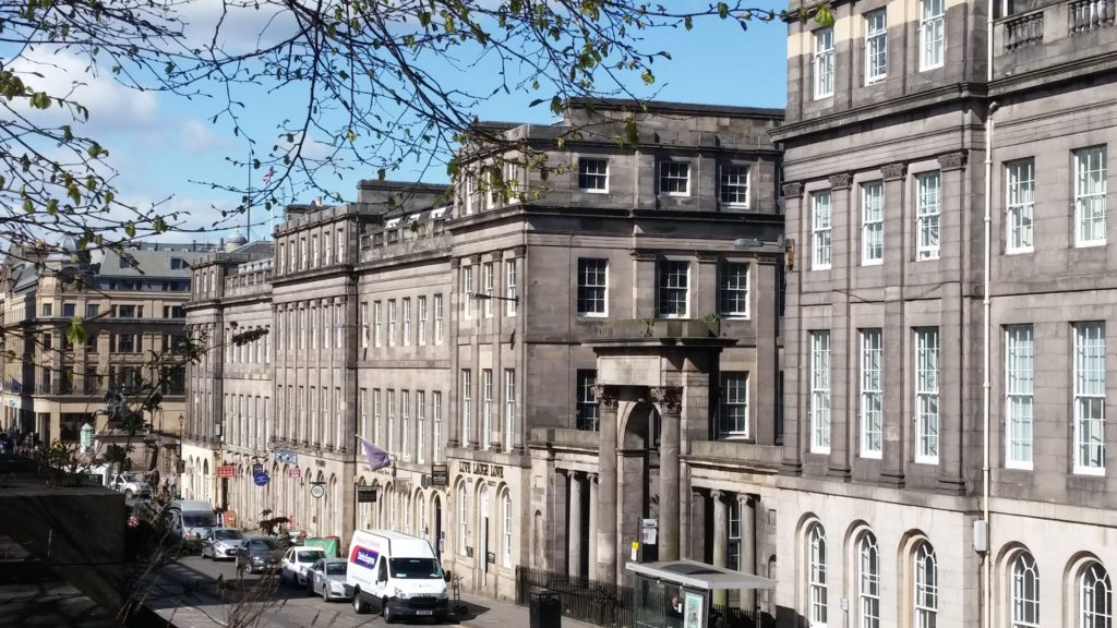 A view of Waterloo Place in Edinburgh's New Town, showing the stunning Georgian architecture.