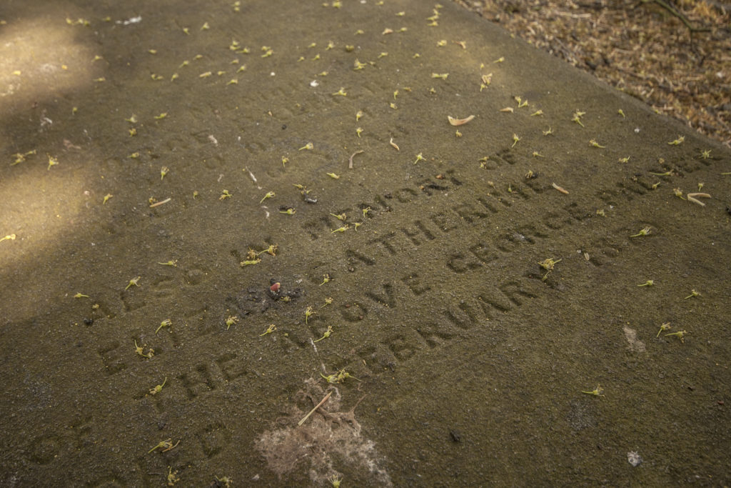 An engraved tombstone.