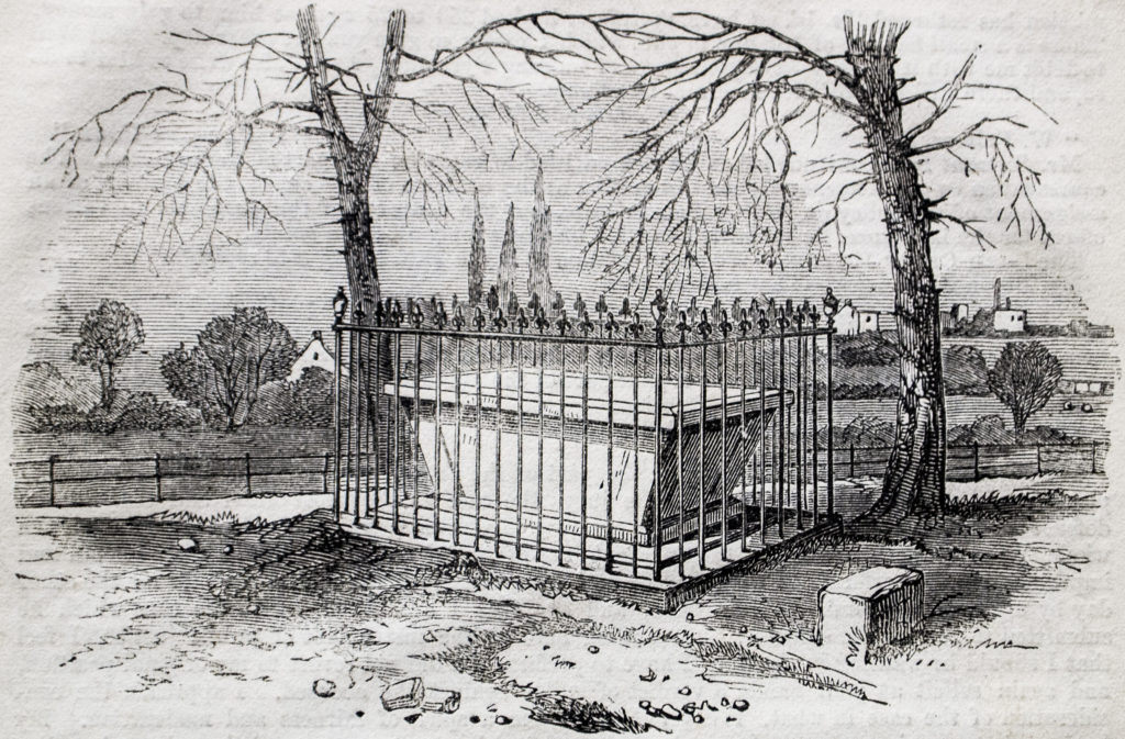 An engraving of a tomb with railings around it.