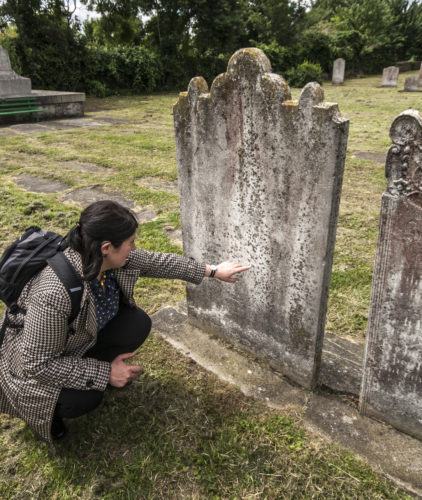 Reading the headstone of Taylor's parents in Northfleet, Kent